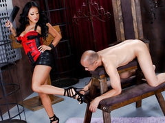 Undressed slave guy stands still in front of darksome haired latin domina Kiara Mia. That babe makes him take up with the tongue her legs and feet before this babe bares her massive tits and large juicy ass. That babe widens her large buttocks right in fr