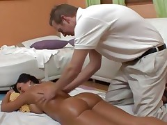 An oiled up naked Lisa Ann gets an after massage fuck