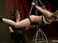 fastened with leather belts and hanged