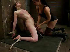 brunette milf punishing a cutie with shaved cunt
