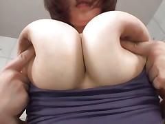groping a pair of huge soft boobs