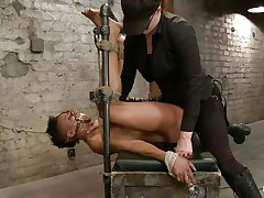 black vibrator on a bound black whore