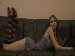Busty Beata coed teasing on the sofa