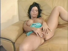 Raven haired busty Sabrina Dotee spreads her legs and strokes her hairless fur pie like crazy in this solo scene. That babe can't stop rubbing her bare snatch. Sabrina Dotee puts her hands on her fake boobs from time to time.
